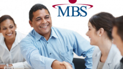MBS promo image; business professionals shaking hands at table